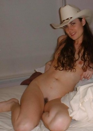 Slender Brunette Posing Nude On Bed In Hat And Without