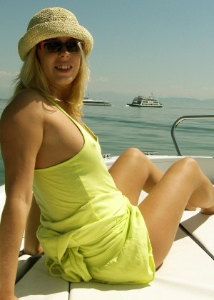 Photo of a woman sunbathing on a boat