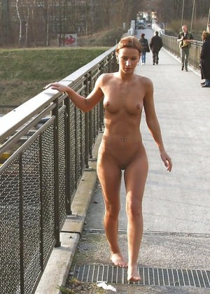 Beautiful German woman walking nude outdoor