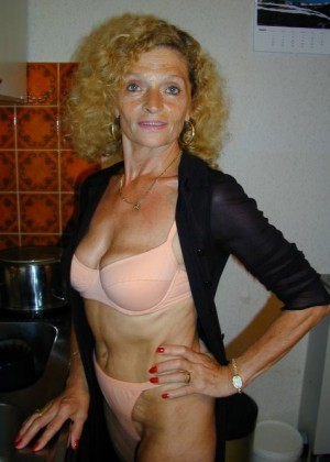 Mature curly-haired Sandy has sex with vibrators
