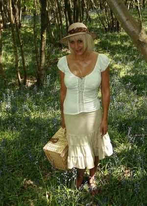 Blond milf undressed on a picnic in the forest