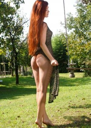 Redheaded Mia Soli shows a tight slit