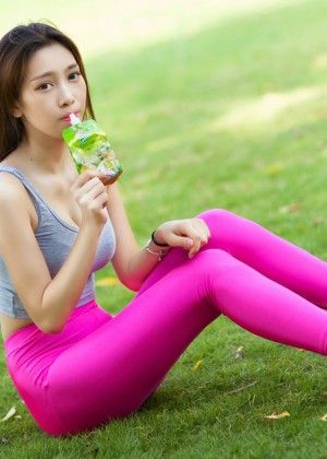 Chinese woman in pink tight leggings