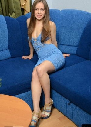 Magnificent Anya on a blue couch