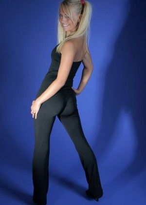 Blonde in a tight suit for yoga