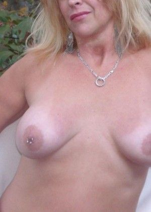 Pierced nipples of an old blonde