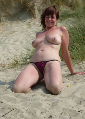 Mature Englishwoman naked on an empty beach