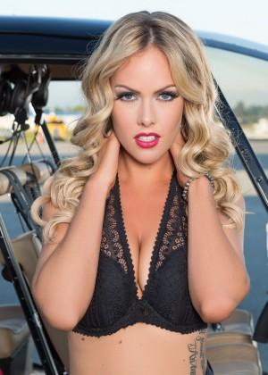 Canadian model Heidi Michelle undresses near helicopter