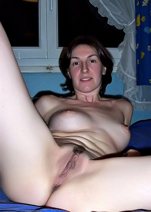 Naked French milf with legs apart