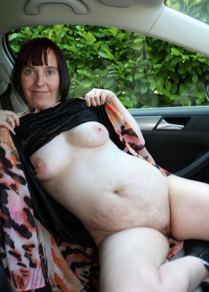 Mature British flashing nude body in the car