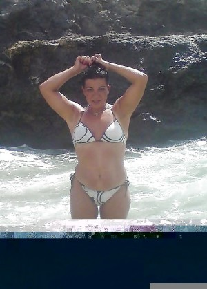 Sexy mature Greek woman Mara on the beach in a bikini