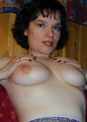 A mature woman from Norway shows her breasts and wet vagina