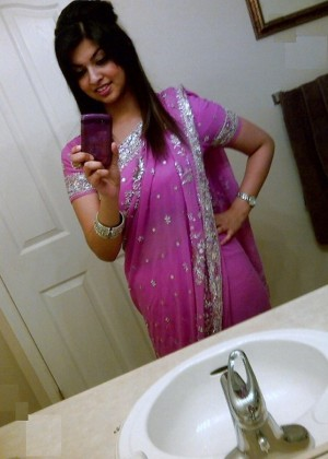 Pakistani student doing selfie in the bathroom