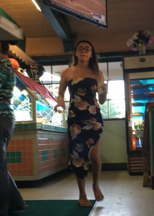 Leg of under Mexican's dress in cafe