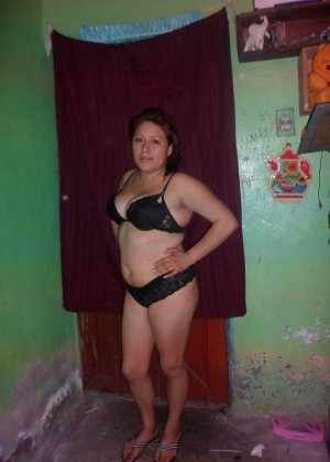 A plump Mexican woman is completely naked