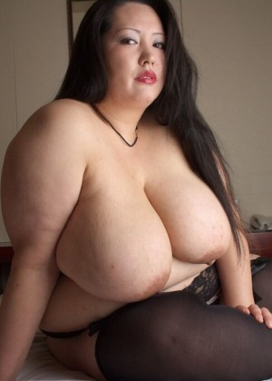 Thick Japanese woman shows huge tits