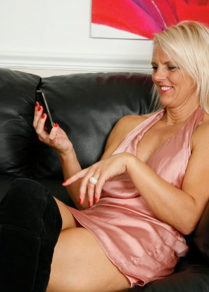 Mature blonde having sex on the phone