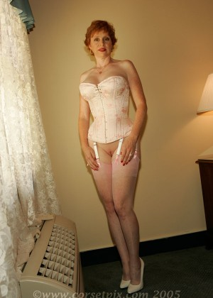 Mature in a pink corset