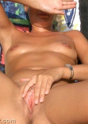 Woman masturbating on the beach