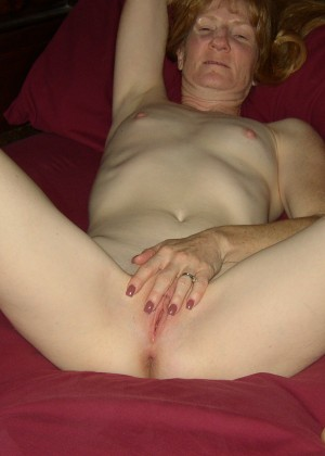 Mature redhead woman funs with sex toys